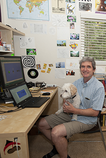 Professor of Chemistry Dan O'Leary and his dog, working from home teaching online classes